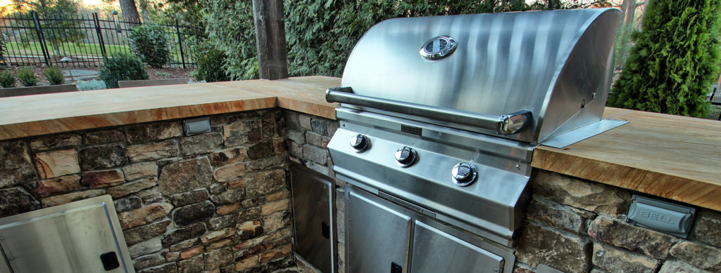 Outdoor Kitchen with Grill installed in backyard in Charlotte by Benton Outdoor Living