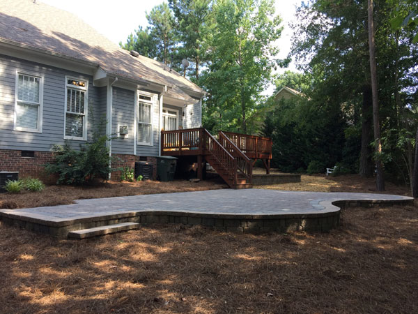 Backyard in Lake Wylie after phase one of backyard plan is completed by building a patio