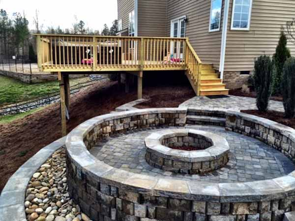 Fort Mill Hillside Oasis where we built a fire pit and a deck to give the backyard some livable space