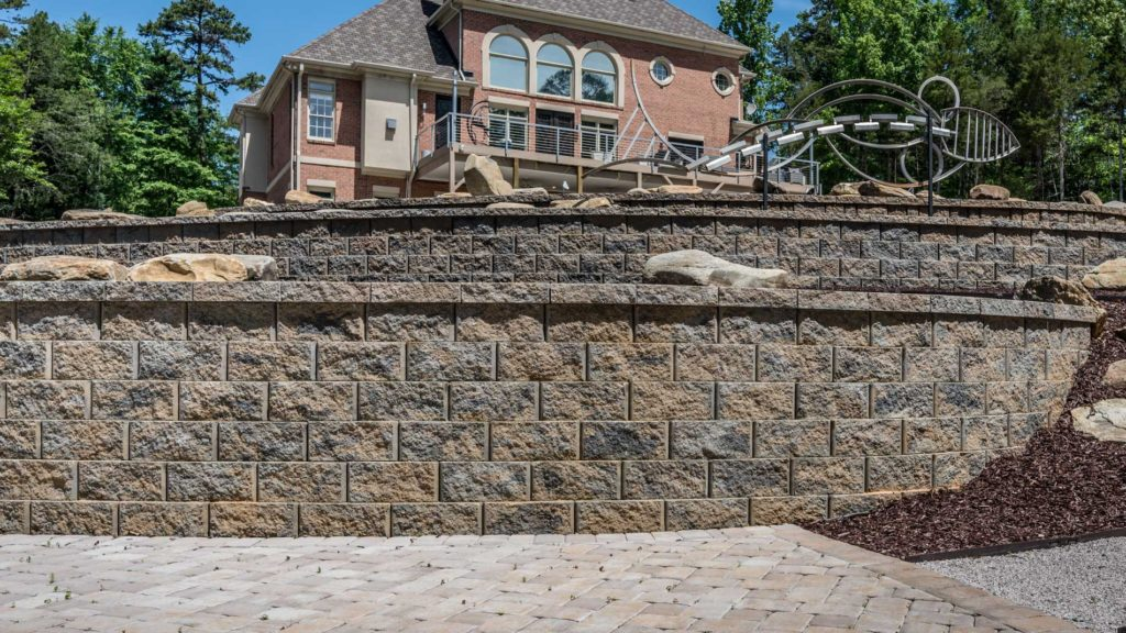 Retaining wall as part of a terrace system in a Charlotte metro area backyard hardscape.