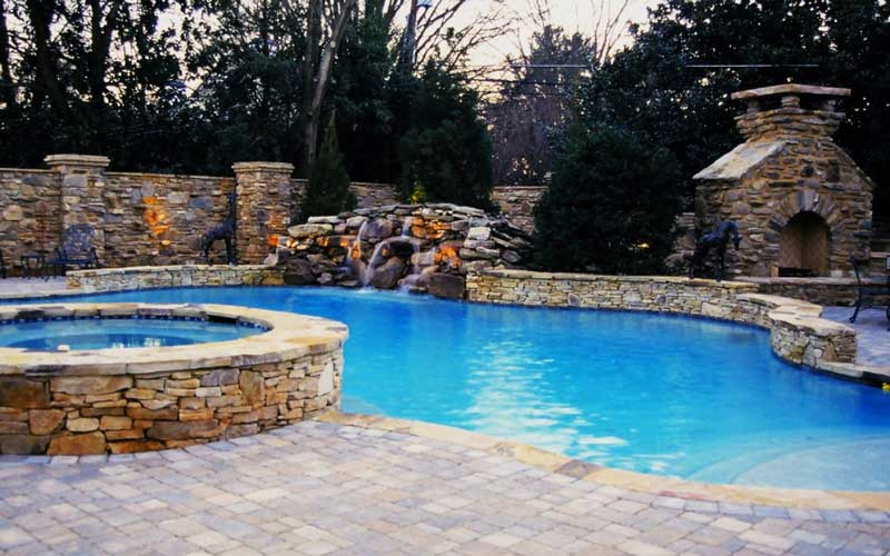 Pool, Fireplace and hardscape completed by Benton Outdoor Living