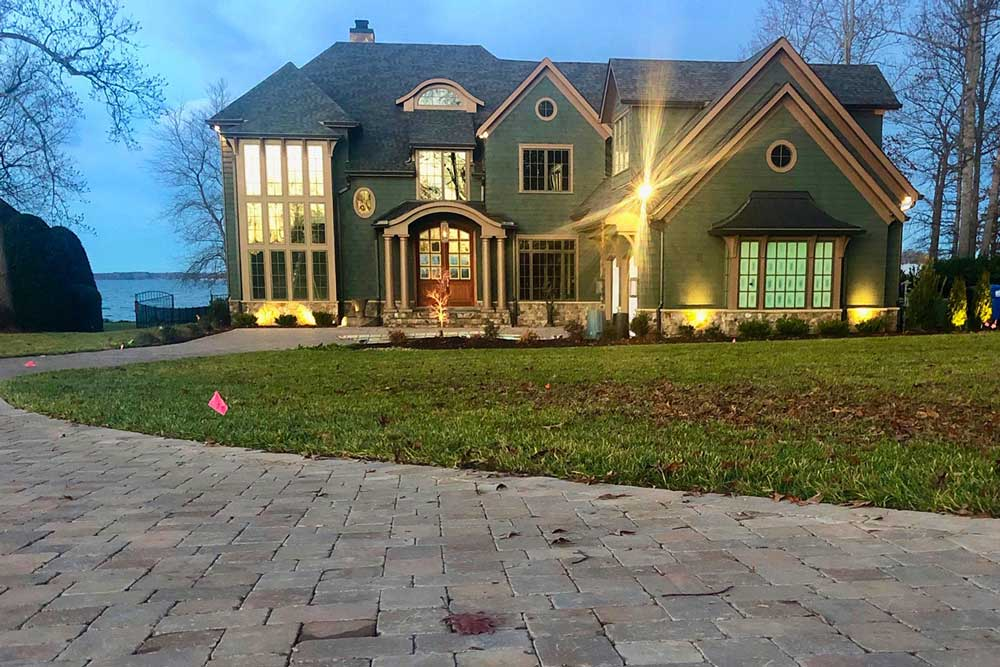 Front of Lake house with Paver Driveway and Landscape Lighting