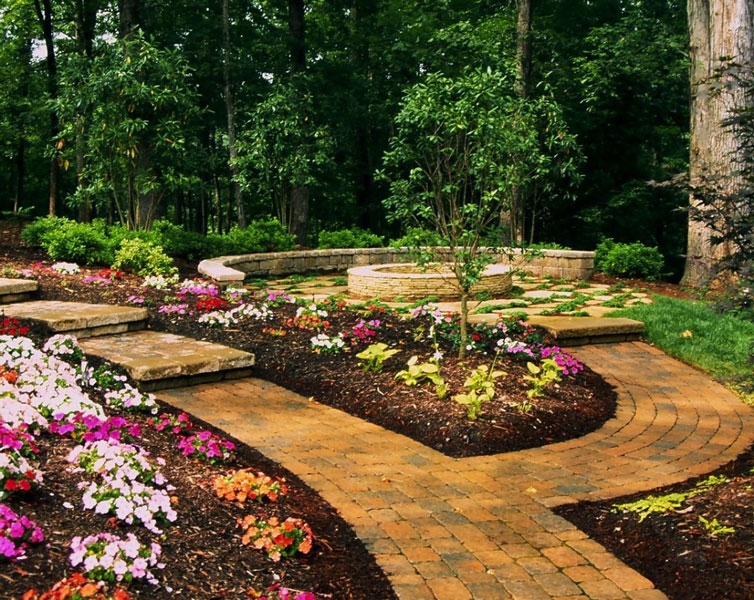 paver walkway that goes through a Charlotte area backyard and branches off to a fire pit by Benton Outdoor Living