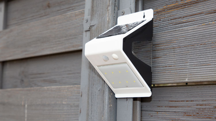 Motion Sensor Light on the side of a building for security lighting purposes.