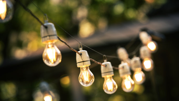 Outdoor lighting idea - add overhead string lighting above your patio or other outdoor area as in this photo.