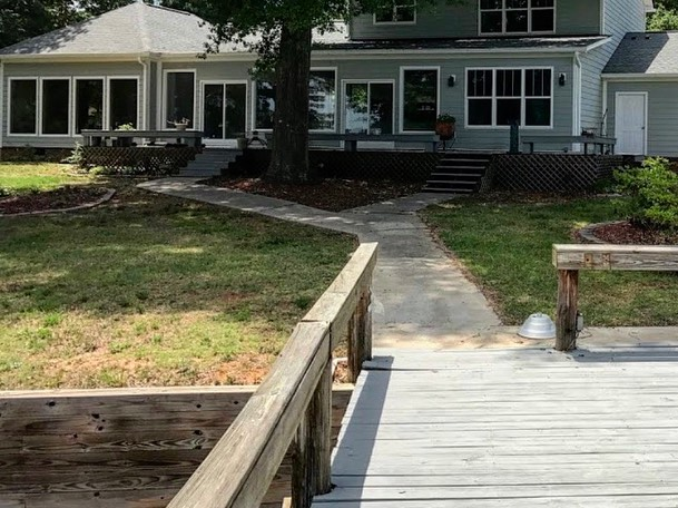 Lake Wylie, SC backyard landscaping transformation before photo of dock and yard