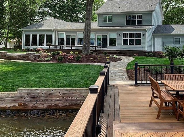 Lake Wylie lake home yard transformation with new planting ares, paver walkway and improved dock by Benton Outdoor Living