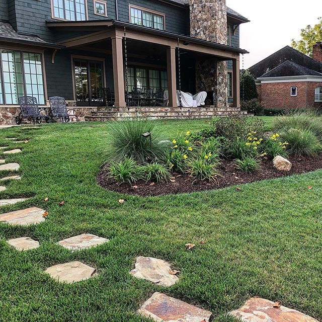 Lake Norman landscaping with plant bed and stepping stones by Benton Outdoor Living