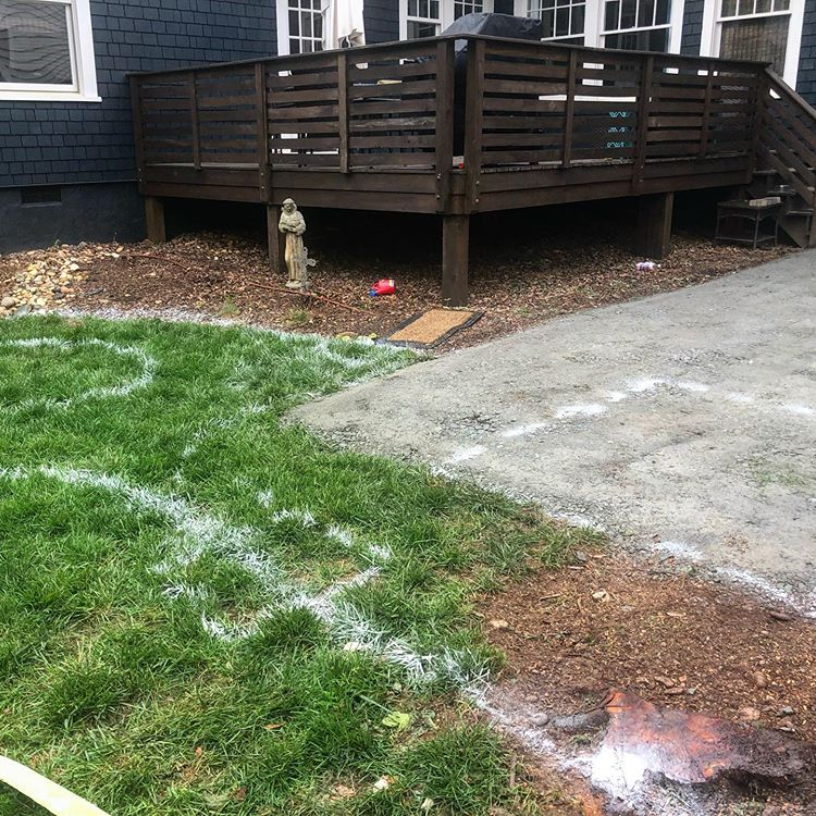 Charlotte backyard marked with new patio location where a parking spot once was.