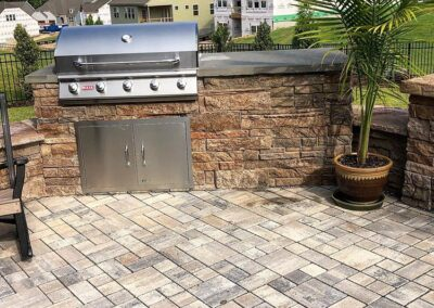 Grill area built into a patio and wall in a Charlotte area backyard.