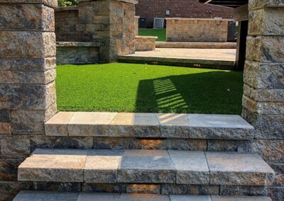 Paver walkways with a grassy area and walls to create a private garden area in a palisades, charlotte backyard