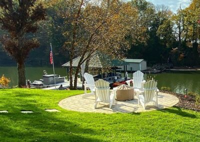 Lakeside backyard round patio with pavers in the Charlotte Area
