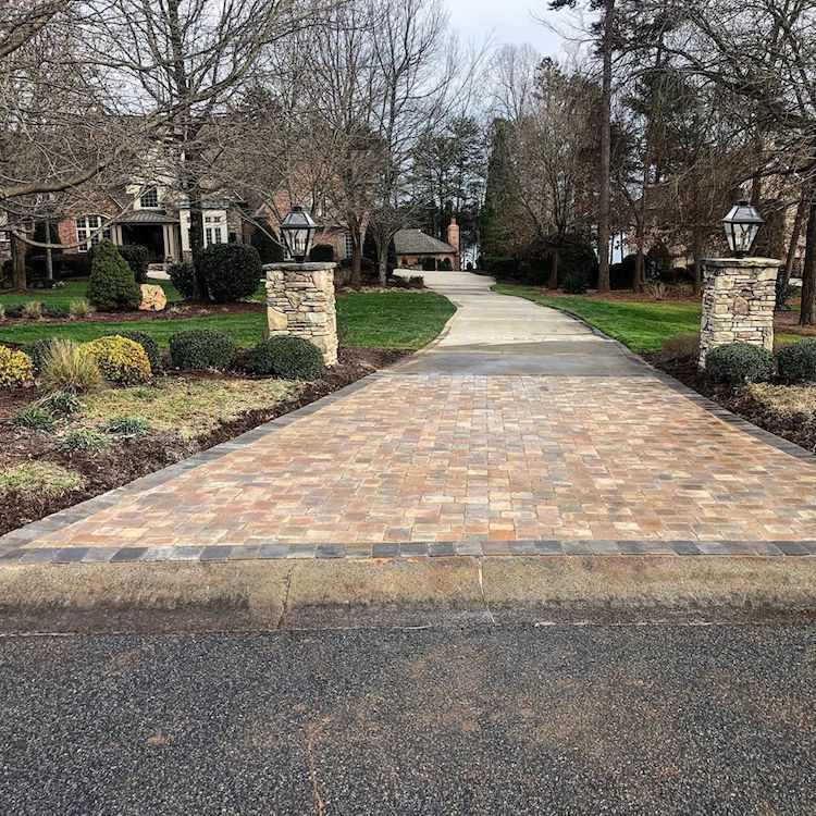 Lake Norman paver driveway entrance with paver light posts