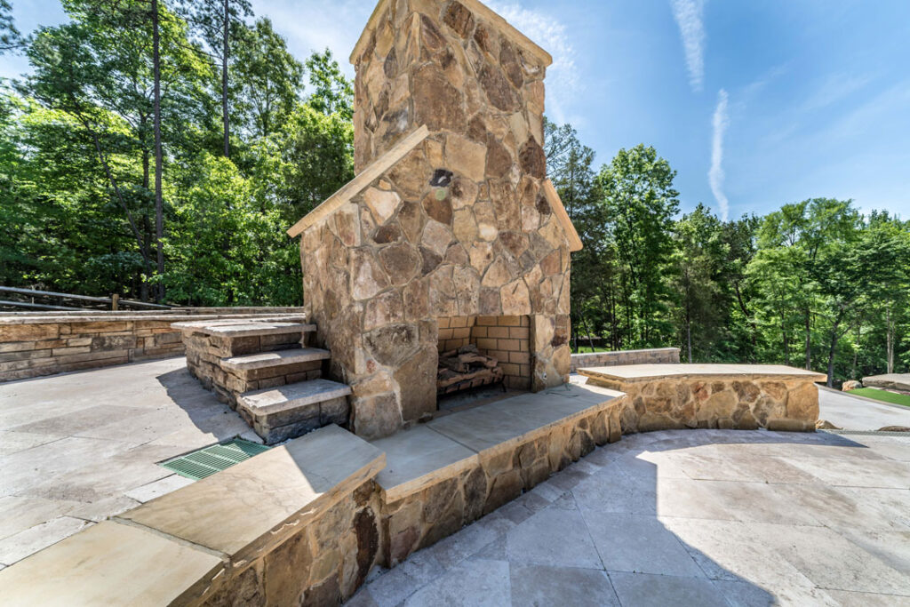 Outdoor Fireplace built by Benton Outdoor Living in the Charlotte, NC area backyard