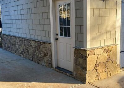Stone Detailing added to the side of this Lake Wylie garage to match the house by Benton Outdoor Living