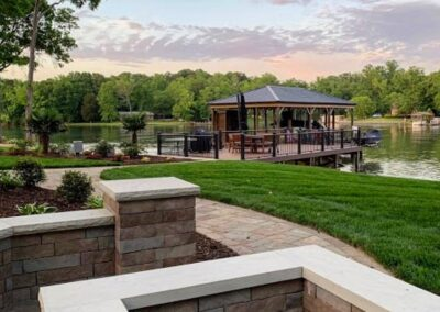 Lake Wylie Fire pit overlooking the lake installed by Benton Outdoor Living